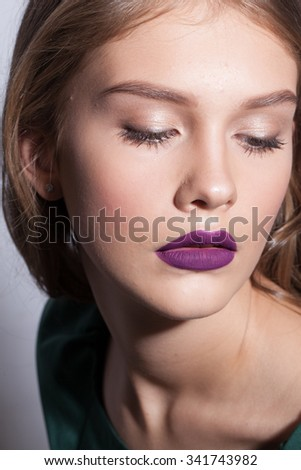 beautiful girl with lilac lips looking down
