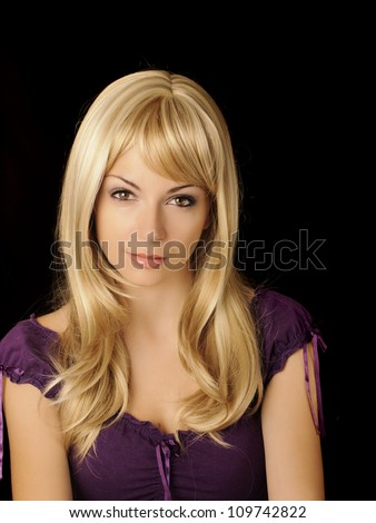 Beautiful girl with long blond hair looking at camera - stock photo