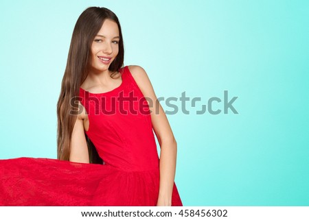 beautiful girl with long brown hair in red dress