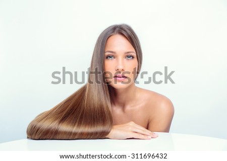 Beautiful girl with long hair - stock photo
