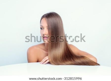 Beautiful girl with long hair - stock photo