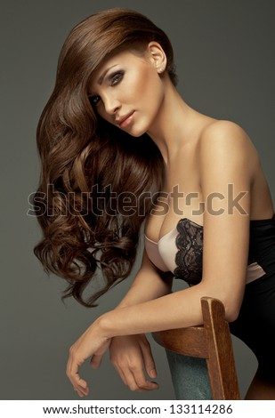 Beautiful girl with long Hair and perfect makeup - stock photo