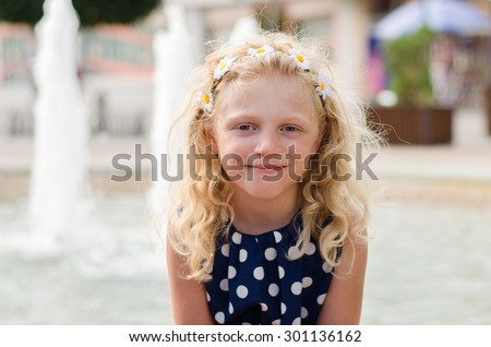 beautiful girl with long hair sitting and watching - stock photo