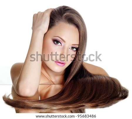 Beautiful  girl with long straight hair, isolated on white background - stock photo