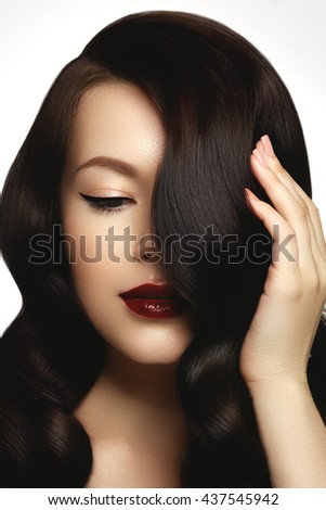 Beautiful girl with long wavy hair. Brunette with curly hairstyle. Hair Extension. Beautiful brunette girl. Healthylong curly hair - stock photo