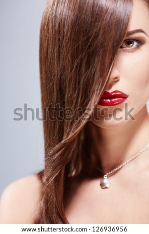 Beautiful girl with make-up in studio - stock photo