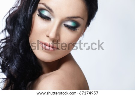 Beautiful girl with make-up with closed eyes on a white background - stock photo