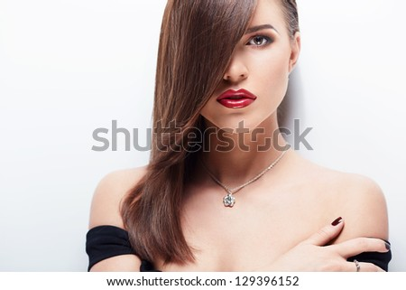 Beautiful girl with makeup on white background - stock photo