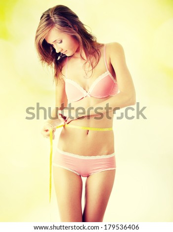 Beautiful girl with meter  - stock photo