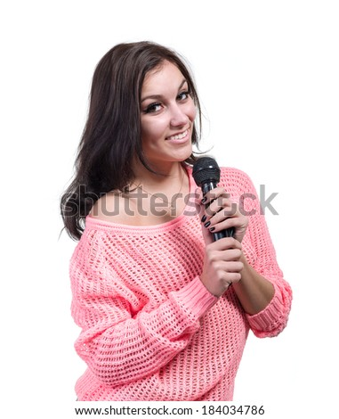 Beautiful girl with microphone isolated on white background - stock photo