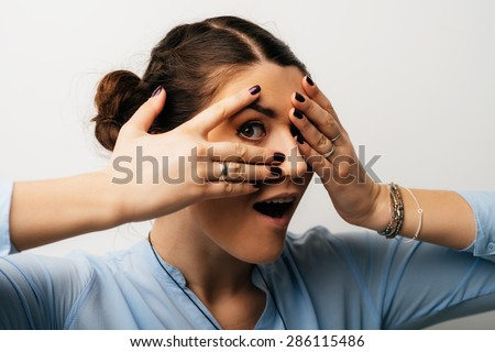 beautiful girl with one eye spies - stock photo