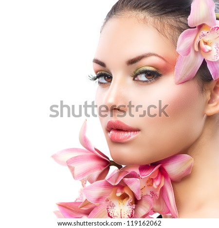 Beautiful Girl With Orchid Flowers.Beauty Model Woman Face. Perfect Skin. Professional Make-up.Makeup.Isolated on a White Background - stock photo