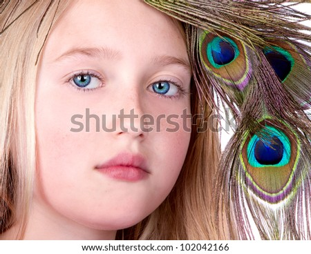 Beautiful Girl with Peacock Feather head dress, close-up isolated on white - stock photo