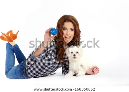 beautiful girl with perfect skin and long wavy hair with a fluffy white dog on a white background