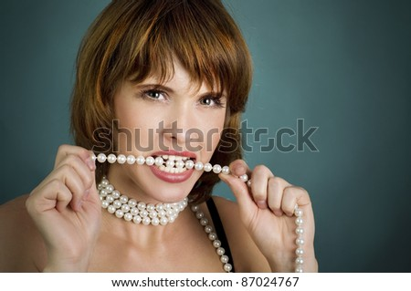 beautiful  girl with perls an red lips - stock photo
