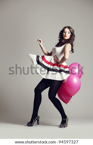 beautiful girl with pink gallons - stock photo