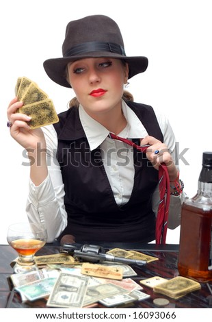 Beautiful girl with playing cards and gun isolated over a white background - stock photo