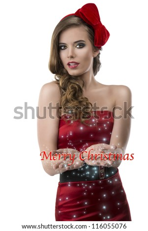 beautiful girl with red and elegant dress and one bow in the hair, she looks in to the lens with open and joined hands - stock photo