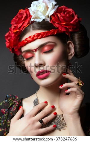 Beautiful girl with red lips and flowers - stock photo