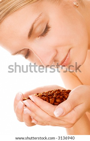 Beautiful girl with roasted coffee beans