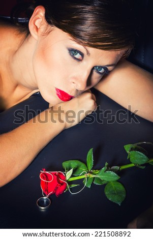 Beautiful Girl With rose.Beauty Model Woman Face. Perfect Skin. Professional makeup.  - stock photo