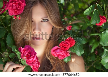 Beautiful girl with roses. Beauty model woman face. Perfect Skin. Professional Make-up.Makeup. Fashion Art - stock photo
