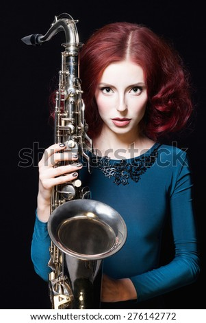beautiful girl with saxophone.young sexy body woman play sax.musical instrument.jazz - stock photo