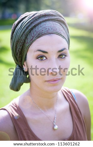beautiful girl with scarf safi on the lawn in autumn