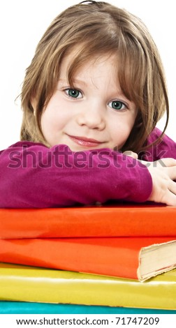 Beautiful girl with school books on the table. - stock photo