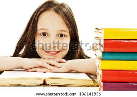 Beautiful girl with school books on the table. Isolated on a white background