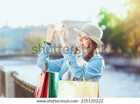 Beautiful girl with shopping bags and mobile phone - stock photo