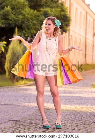 Beautiful girl with shopping bags in action. Shopping concept. Lens Flare