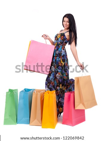 Beautiful girl with shopping bags on white background.