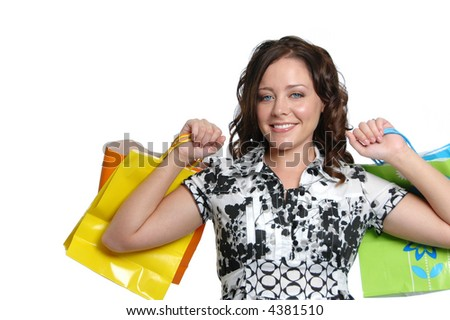 Beautiful girl with shopping bags on white background - stock photo