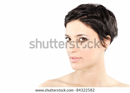 beautiful girl with short black hair, against white background - stock photo