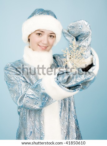 Beautiful girl with snowflake in new year costume - stock photo