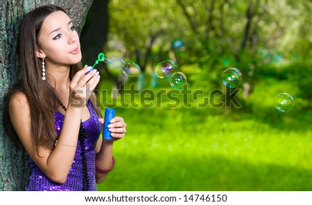 Beautiful girl with soap bubbles