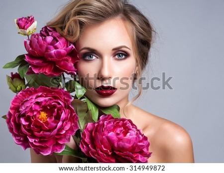 Beautiful Girl with Spring Flowers.Fresh skin - stock photo