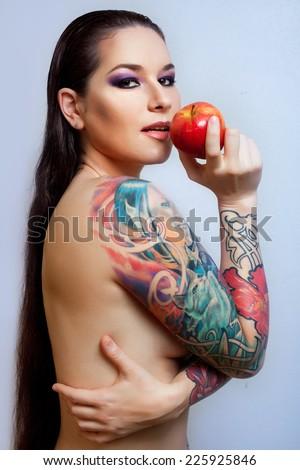 Beautiful girl with stylish make-up and tattooed arms. tattoo - stock photo
