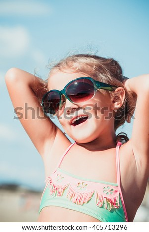 beautiful girl with sunglasses on the beach