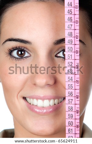 Beautiful girl with tape measure isolated on a over white background - stock photo