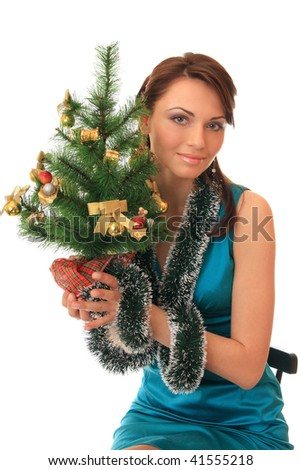 Beautiful girl with the decorated new-year tree. - stock photo