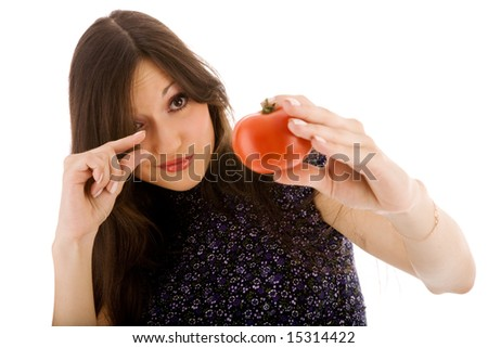 Beautiful girl with tomato on the white