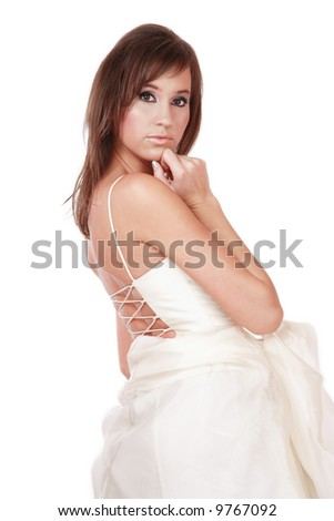Beautiful girl with trendy makeup and in bridal dress looking at us thoughtfully