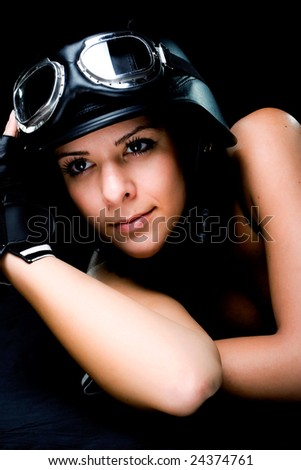 beautiful girl with US Army-style motorcycle helmet with goggles and gloves - stock photo