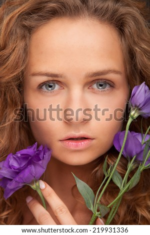 Beautiful Girl With violet Flowers. Beauty Face - stock photo