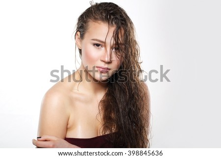 beautiful girl with wet hair on a white background. girl in a wet dress. Photography is very sharp, bright, beautiful. Young sexy woman.