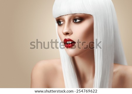 Beautiful girl with white hair and red lips - stock photo