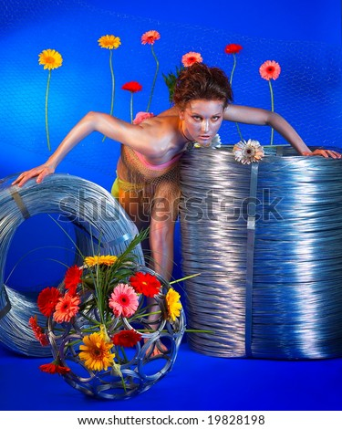 beautiful girl with wire rolls and flowers