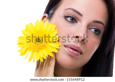 Beautiful girl with yellow flower - stock photo